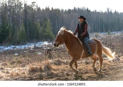 Cowgirl horseback riding