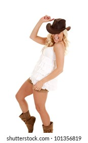 a cowgirl laughing and dancing having some fun.