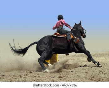Cowgirl Rounding a Drum in the Barrel Race with clipping path