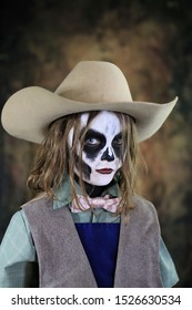 Cowgirl with skull makeup, brown background