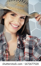 Cowgirl smiling wearing cowboy hat