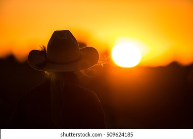 cowgirl in the sunset at a Gymkhana