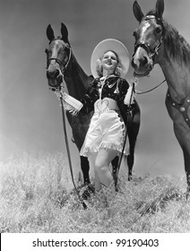 Cowgirl with two horses