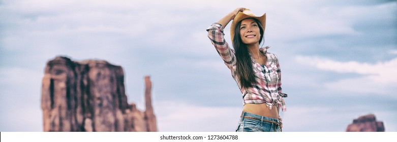 Cowgirl western cowboy hat Asian woman walking in Monument Valley. Beautiful young girl in summer outdoors, Arizona Utah, USA. Banner panorama.
