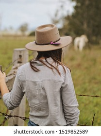 Cowgirl Wondering How She's Going To Herd the Last Cow into The Yards