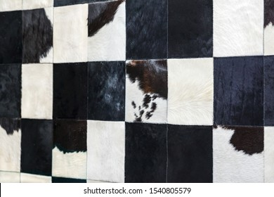 Cowhide with black and white hair. Square cut leather made into a blanket or coat and carpet.