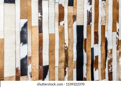 Cowhide rug, leather patchwork texture background