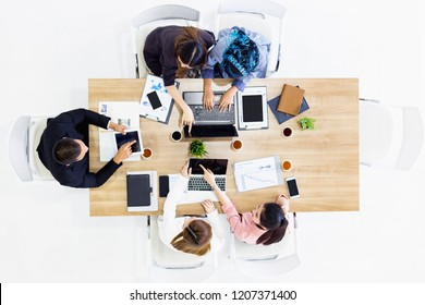 Co-workers of business team work working on his laptop phone in modern office room, business woman typing on computer sitting at White table, Top view