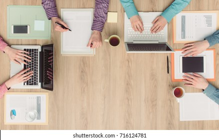 Coworkers and business team working together at office desk, cooperation and meetings concept