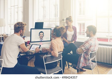 Coworkers doing a video conference in the conference room