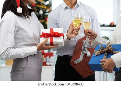 Coworkers exchanging Christmas presents at office party