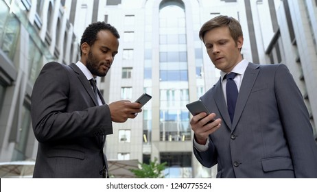 Coworkers exchanging contacts on smartphones profitable acquaintance, social app