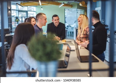 Coworkers having fun and laughing at the office meeting