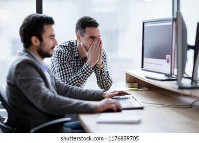 Coworkers having problem with computer in office