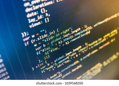 Coworkers team in modern office. SEO optimization. Server logs analysis. Writing programming functions on laptop. Programmer occupation job. Binary digits code editing. Software source code.