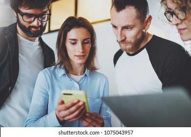 Coworkers team working with mobile devices at modern office.Business meeting concept