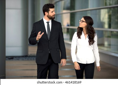 Coworkers walk at workplace business CEO boss and assistant talk strategy