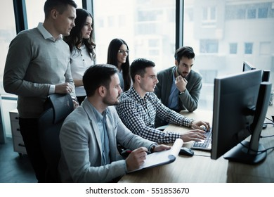 Coworkers working on project together in company office