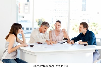 Coworkers working in their office at work