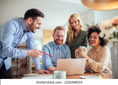 Coworkers working together in apartment