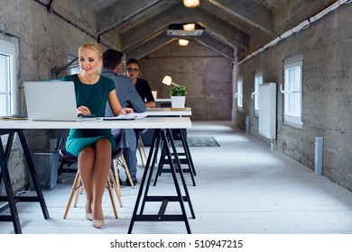 Coworking space - business people working in the office per hour