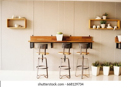 Co-working space with vintage working table and high chair in warm tone