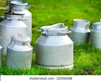 cow's milk in various metallic cans