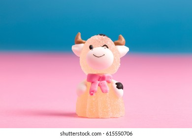 A cow-shaped candy in a yellow dress