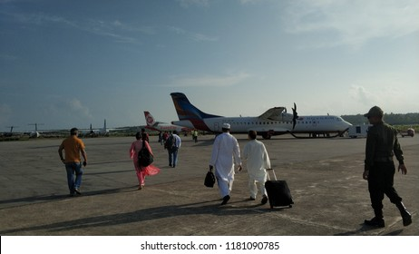 cox bazaar Bangladesh on September 11, 2018: people was walking to airplane