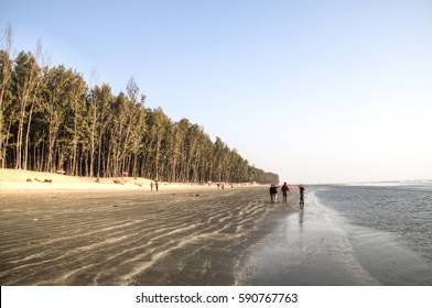 COX'S BAZAR, BANGLADESH - FEBRUARY 2017: People on the longest beach in the world in Cox's Bazar in Bangladesh