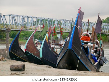 Cox's Bazar, Bangladesh - June 6, 2018 - A sampan-style fishing boat sits idle at low tide in a small fishing village south of Cox's Bazar.