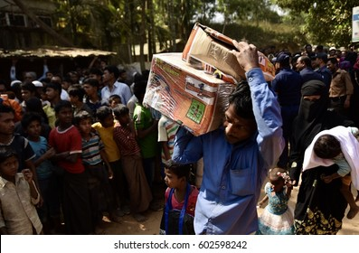 Cox's Bazar, Bangladesh - March 17, 2017 -  Rohingya refugees receive food aid in Kutupalong camp near Cox's Bazar