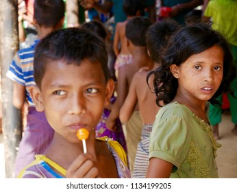 Cox's Bazar, Bangladesh - May 29, 2018 - Rohingya refugee children line up for candy at a food distribution centre in Camp 16 near the southeastern tip of Bangladesh.