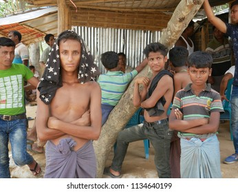 Cox's Bazar, Bangladesh - May 29, 2018 - Rohingya boys pass time in refugee Camp 16 in southeastern Bangladesh.
