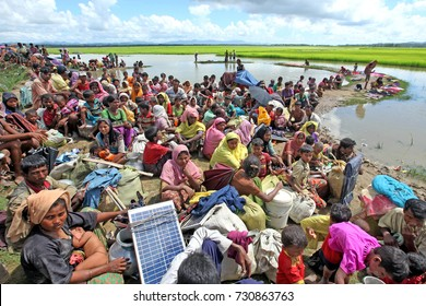 COx'S BAZAR, BANGLADESH - OCTOBER 09, 2017: Rohingyas on hold at the border. Over 10,000 Rohingya refugees intruded off from Palongkhali in Ukhia of Cox's Bazar fleeing from persecution in Myanmar.