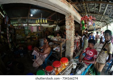 COX'S BAZAR, BANGLADESH: OCTOBER 09, 2017 - The people of Bangladesh are watching television in the store, most of them poor and have no television at home at Dakhinpara.