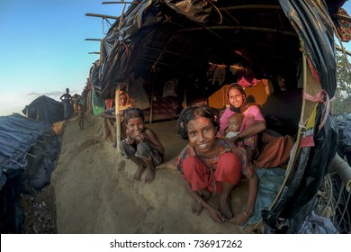 COX'S BAZAR, BANGLADESH: OCTOBER 11, 2017- Rohingya's children smiled in front of their hut in Ukiah. About 600k ethnic Rohingya escaped to Bangladesh due to cruelty in Myanmar.