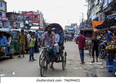 COX'S BAZAR, BANGLADESH : OCTOBER 11, 2017 - People in Bangladesh use trishaws as the main transportation in Chakeriya District.