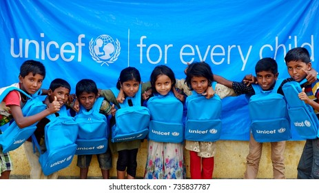 COX'S BAZAR, BANGLADESH: OCTOBER 12, 2017- Face of Children of Rohingya with a Unicef banner and new school bag. United Children Education Foundation (Unicef) give education for refugees children.