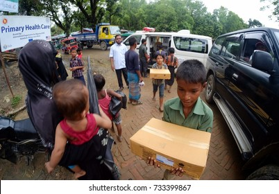 COX'S BAZAR, BANGLADESH: OCTOBER 14, 2017 - Children's of Rohingya helping lifting the medical stock to the Medical Centre Refugees Camp at Kutupalong.