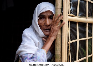COX'S BAZAR, BANGLADESH : OCTOBER 8, 2017 - A Grandmother of rohingya people looking out from tent at Kutupalong Refugee Camp.