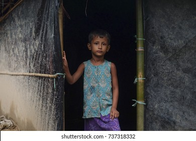 COX'S BAZAR, BANGLADESH: OCTOBER 8, 2017 - Portrait of Rohingya children stand in front of hut at Kutupalong Refugee Camp.