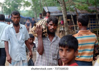 COX'S BAZAR, BANGLADESH: OCTOBER 8, 2017 - Man of Rohingya lift fire wood at Kutupalong. Approximately 600,000 refugees come to Bangladesh to save their lives in the violence in Myanmar.