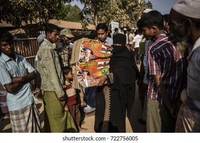 COX'S BAZAR, BANGLADESH - SEPTEMBER 25, 2017 : Rohingya refugees from Myanmar receive help in Kutupalong refugee camp near Cox's Bazar, Bangladesh.