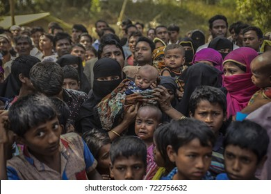 COX'S BAZAR, BANGLADESH - SEPTEMBER 25, 2017 : Rohingya refugees from Myanmar waiting for food aid in Kutupalong refugee camp near Cox's Bazar, Bangladesh.