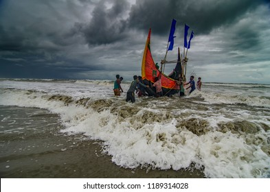 Cox's Bazar, Chittagong, Bangladesh - 6/17/2017 Life of a small fishermen community (village) in Bangladesh. Even if the the sky is dark, they have to head out for their livelihood.