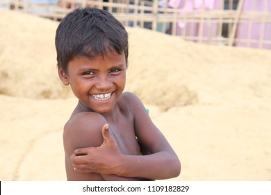 COX`S BAZAR.BANGLADESH- June 7, 2018 , Rohingya a child smiling in front of his hut in Rohingya refugee camps near Cox's Bazar, Bangladesh.