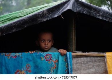 COX'S BAZAR,BANGLADESH:OCTOBER 9,2017-The Rohingya boy stares out from tent at Kutupalong. About 600,000 Rohingya refugees coming to Bangladesh to save their lives in the atrocities happen in Myanmar.