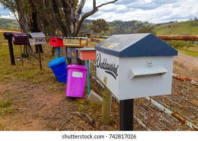Cox's River, Blue Mountains, New South Wales, Australia, October 25, 2017: Rural mailboxes next to a rusty metal fence by the roadside in the Australian countryside.
