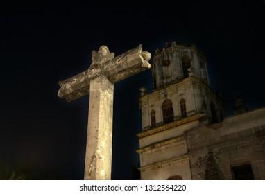 Coyoacan Church cross, Mexico City night scene